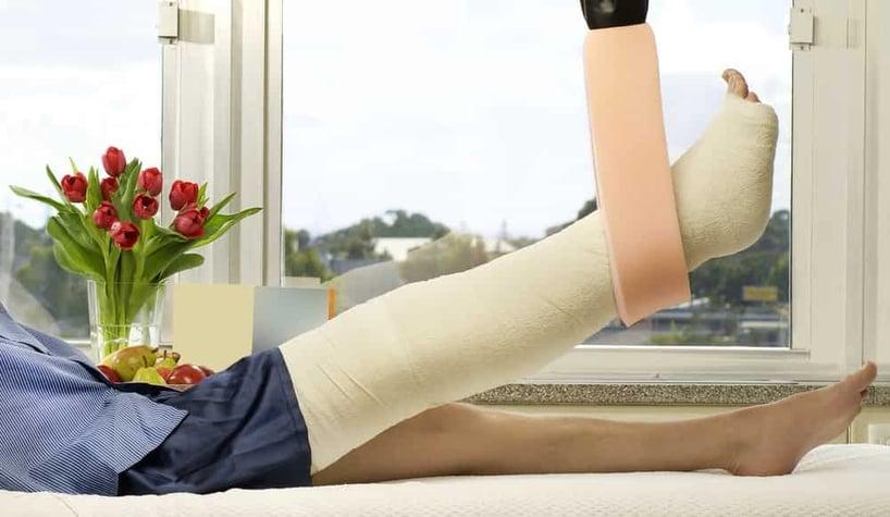 man-in-cast-traction-broken-leg
