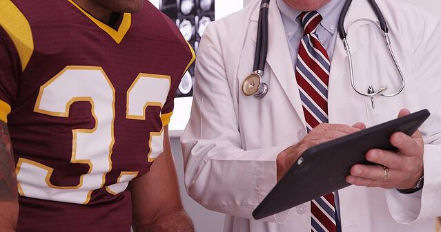 orthopedic_physician_with_football_player