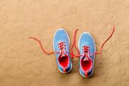 graphicstock-blue-sports-shoes-with-pink-shoelaces-laid-on-sand-beach-background-studio-shot-flat-lay-copy-space_BOGIso9UfW (1)
