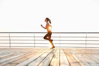 graphicstock-cute-young-sportswoman-running-on-pier-in-the-morning_ru4k0ifB2e