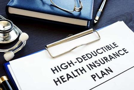 storyblocks-high-deductible-health-insurance-plan-hdhp-on-a-desk_S-_7-aPPQ